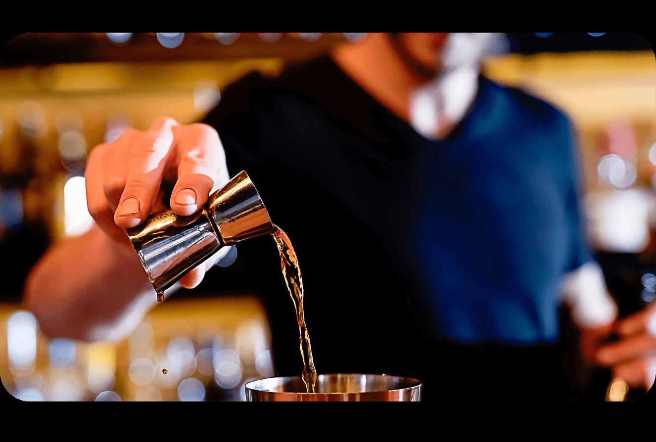 Bartender pouring a shot